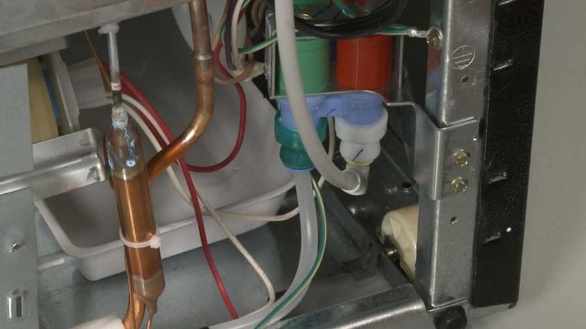 تعویض شیر آب یخچال فریزر